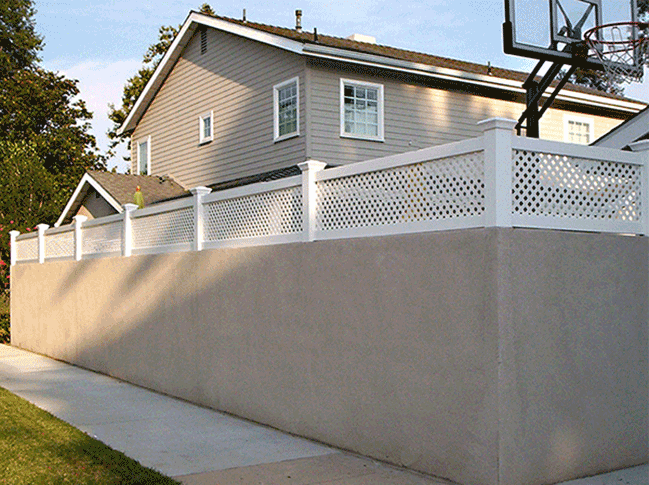 how to install vinyl fence on retaining wall